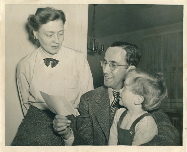 Elfried Hoeber, Johannes Hoeber and their son Tommy admire the $1,000 check from the Philadelphia Record, April 1943.