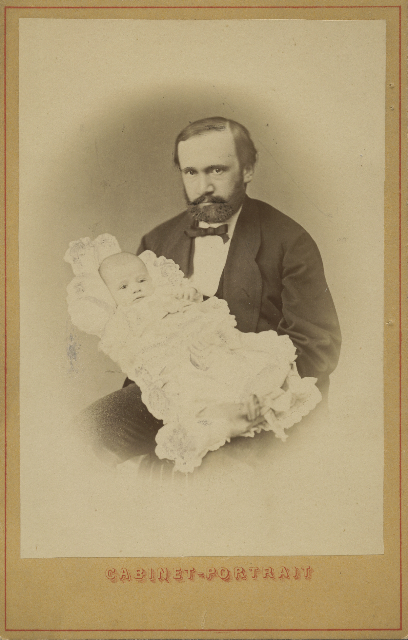 Anselm Höber holding his first son, Eduard, 1871.