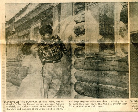 Couple enters one of the new houses dedicated by Elfriede on April 4, 1966. (Anchorage Daily News)