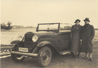 Johannes and Elfriede Höber on a road outside Düsseldorf, Germany, where they lived for several years before they fled to America. (He's wearing knickers and long stockings under that coat.)