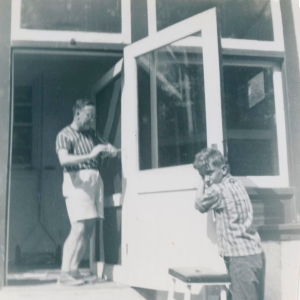 Johannes and his son Tom repair a door at the family's house at 612 West Cliveden St., Philadelphia, 1953