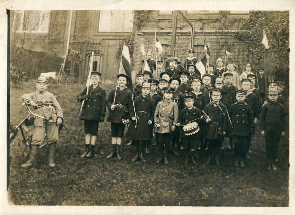 1914. At school, Johannes and his classmates played at being soldiers. Johannes is in the front row, third from the left, wearing a spike helmet [Pickelhaube]. Click on image to enlarge.